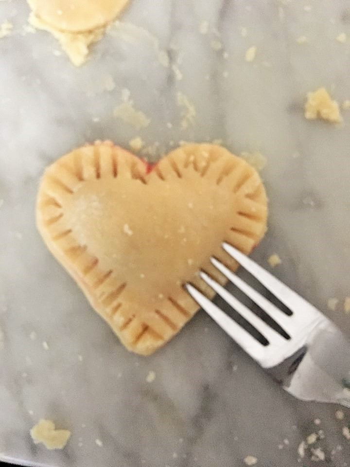 Making mini heart hand pies for Valentines day