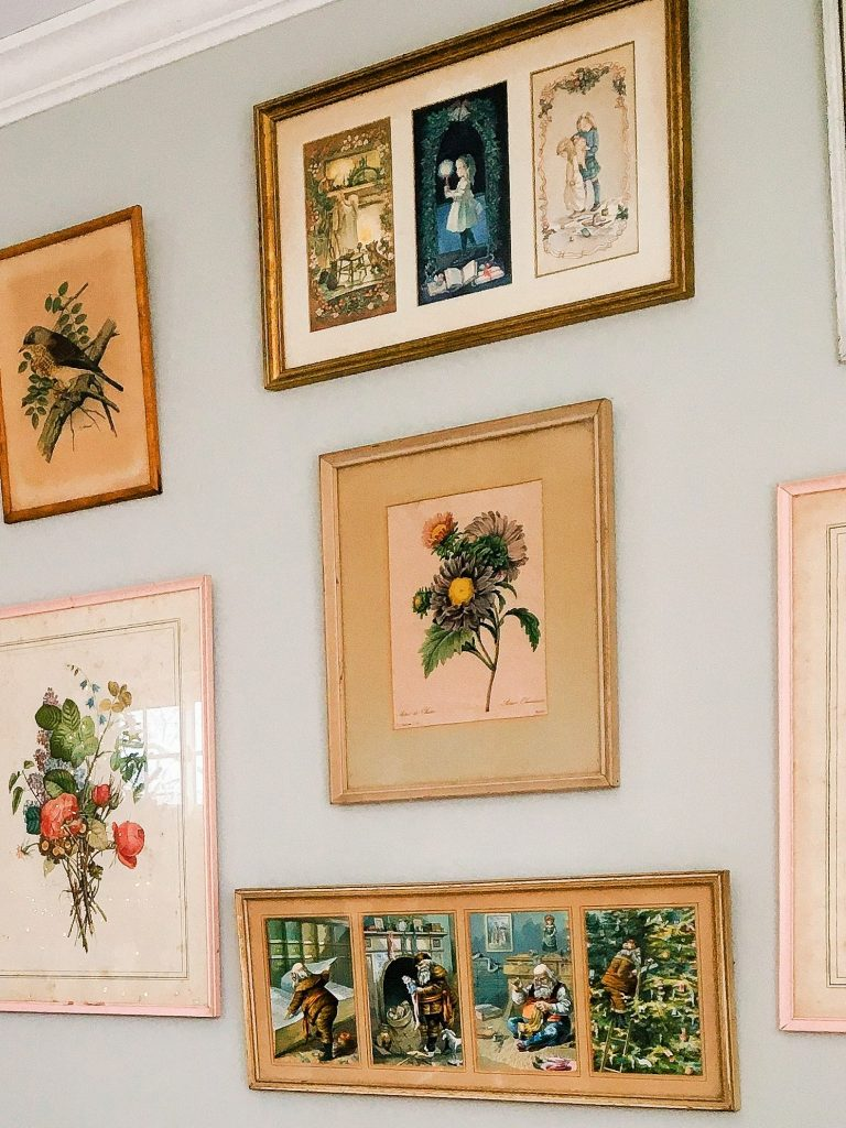 Vintage Christmas prints on a collage wall in my home