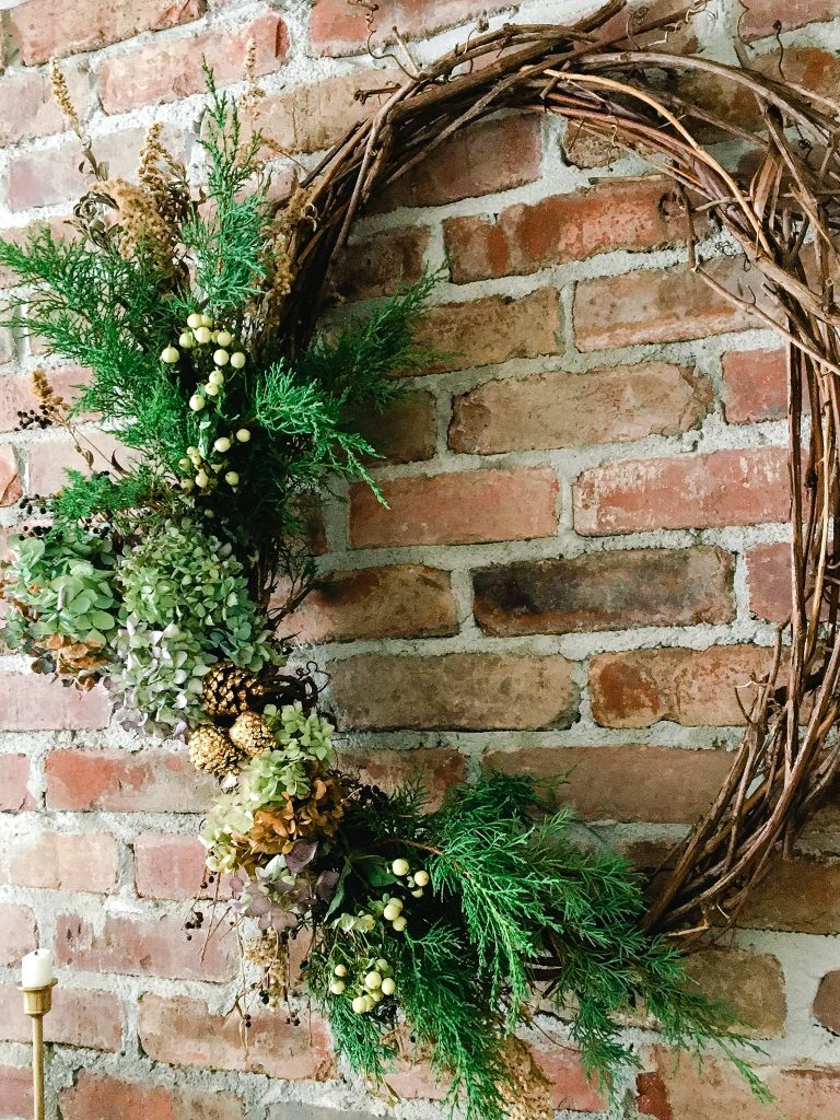 handmade wreath on my vintage Christmas mantle at home
