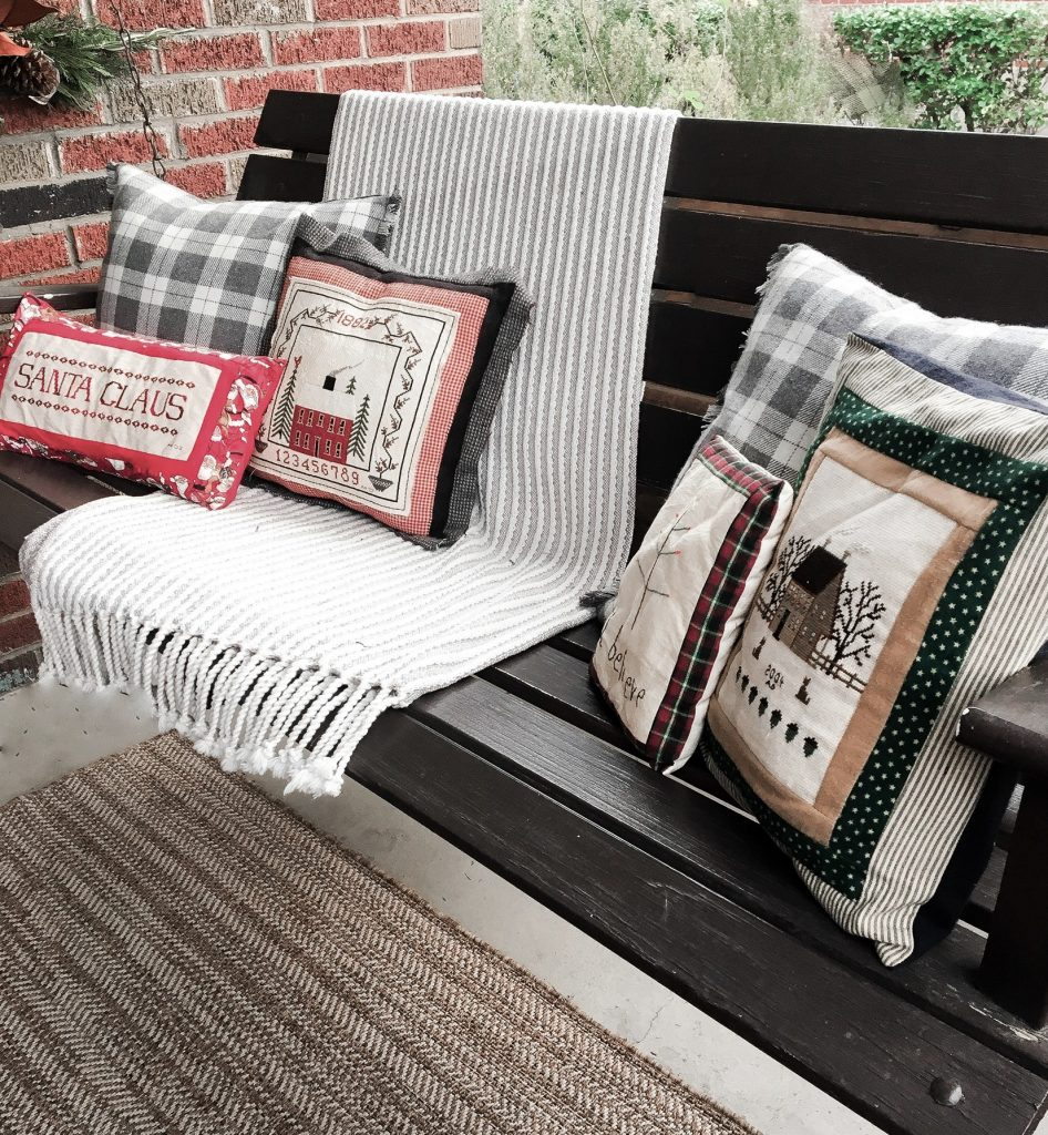 Handmade Christmas Pillows on the front porch swing