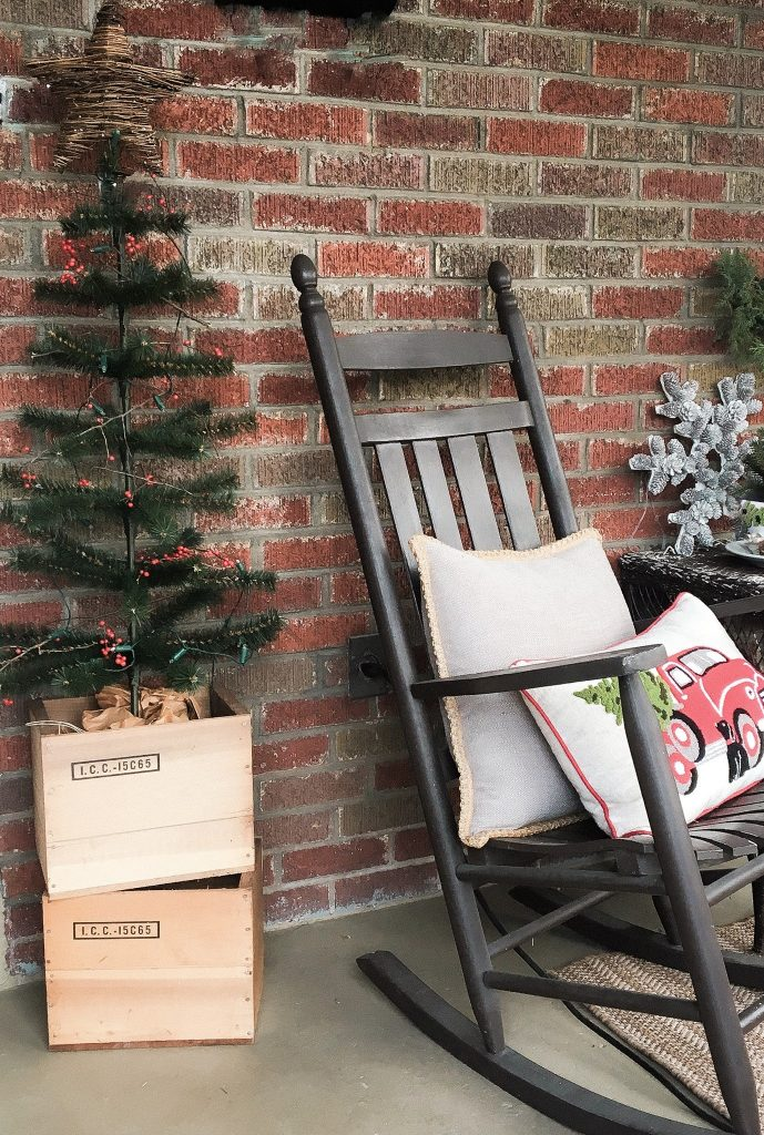 Rocking chair with Christmas pillows on the porch