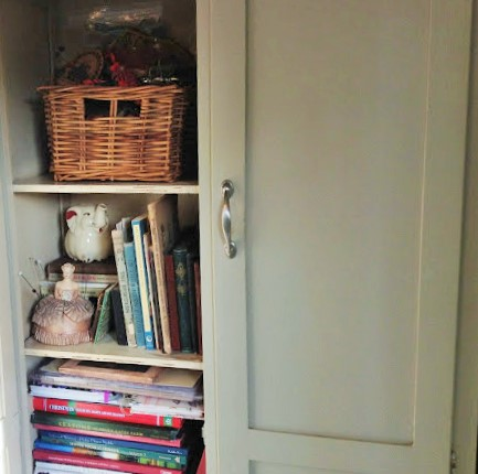 cupboard inside the tiny garden shed studio