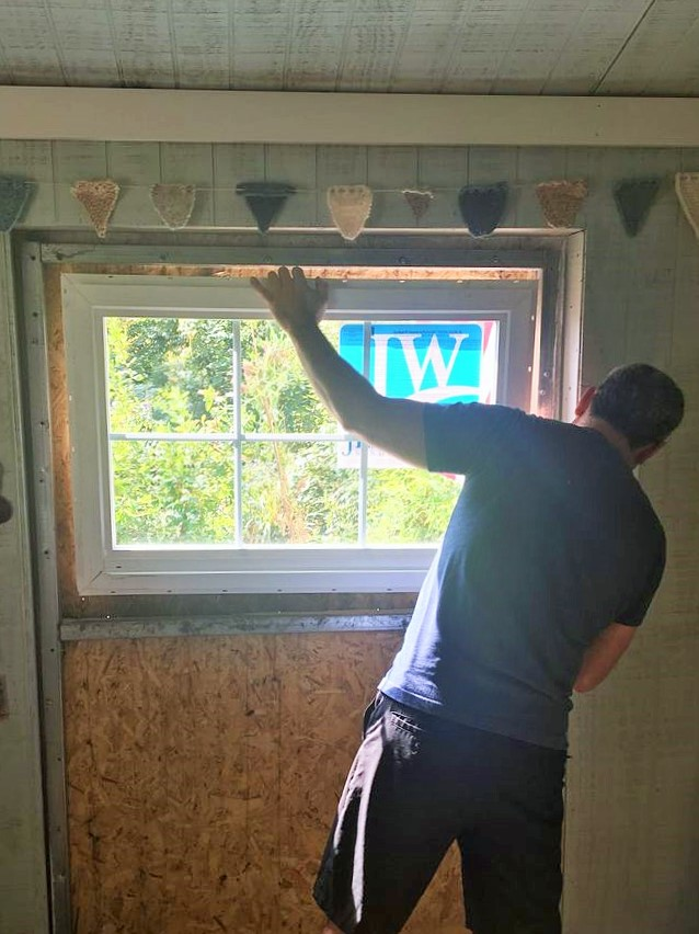 Dino adding the window to the studio shed