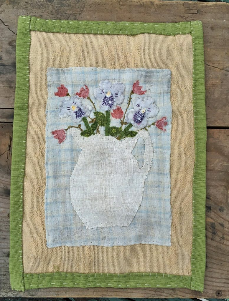 hand stitched textiles to create spring blossoms wall hanging