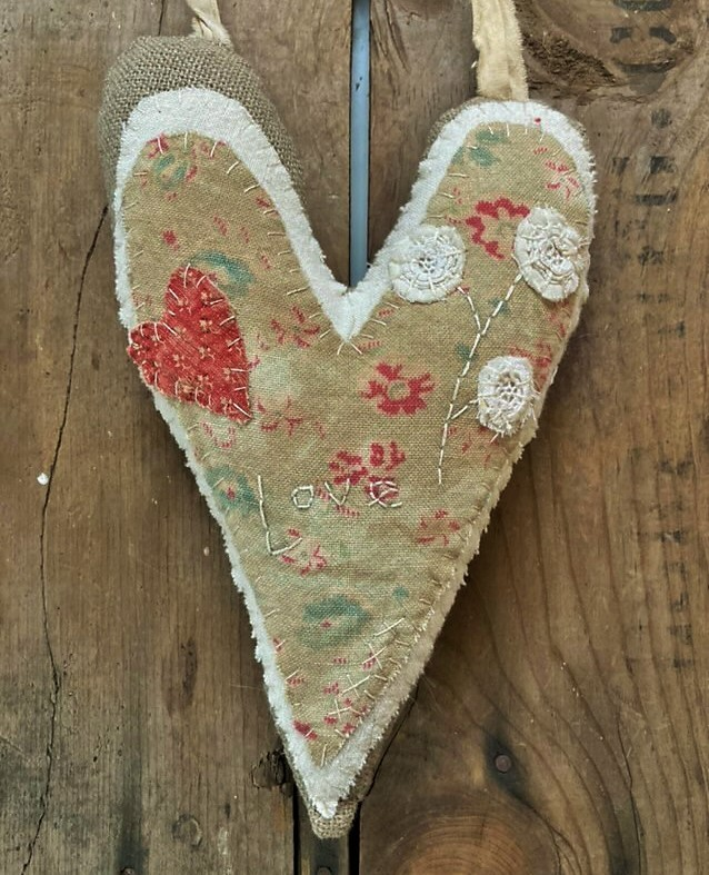 Hanging hand stitched valentine heart with early textiles- Pincushion Flower