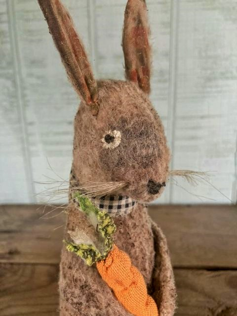 garden bunny rabbit made to look old and well loved.
