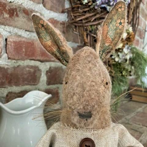 Folk Art Rabbit Doll holding a Strawberry