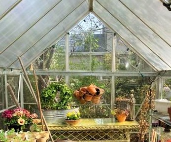 Vintage yellow wicker table in the greenhouse