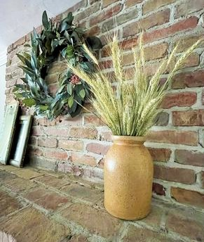 Decorating with vintage mirrors, dried wreath and wheat tucked in an old crock sit upon my mantle for fall