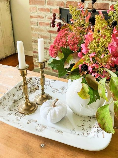 Decorated coffee table for fall using vintage pieces, handmades, and fresh flowers